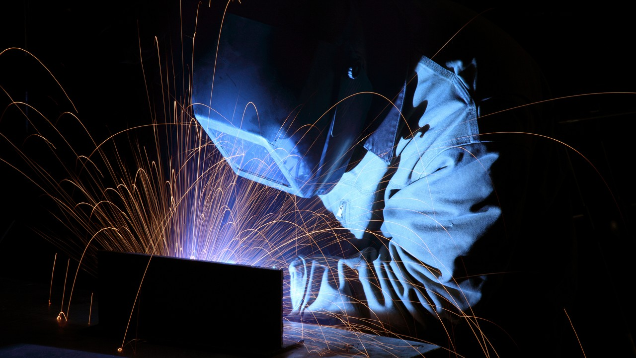 Welder working with sparks flying